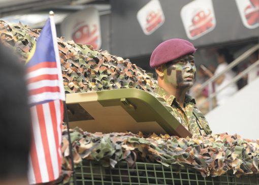 KUALA LUMPUR, MALAYSIA - AUGUST 31: Unidentified Malaysian Army personel sitting on his vehicle during parade celebration of Malaysia Independence day 58th in Merdeka square, Kuala Lumpur, Malaysia on August 31, 2015